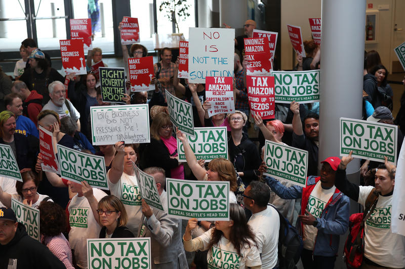 Head tax opponents and supporters crowd Seattle City Hall on Tuesday, June 12, 2018.