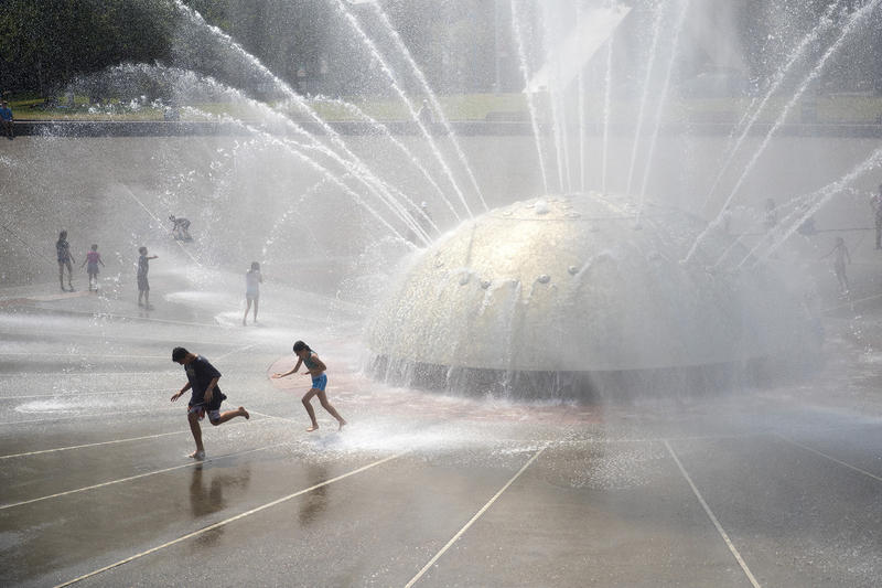Kids play at the International Fountain on Monday, July 30, 2018, at Seattle Center.