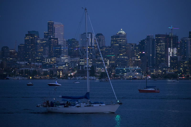 A sailboat is shown as the sun sets on Lake Union, seen from Gas Works Park, on Monday, July 30, 2018, in Seattle.