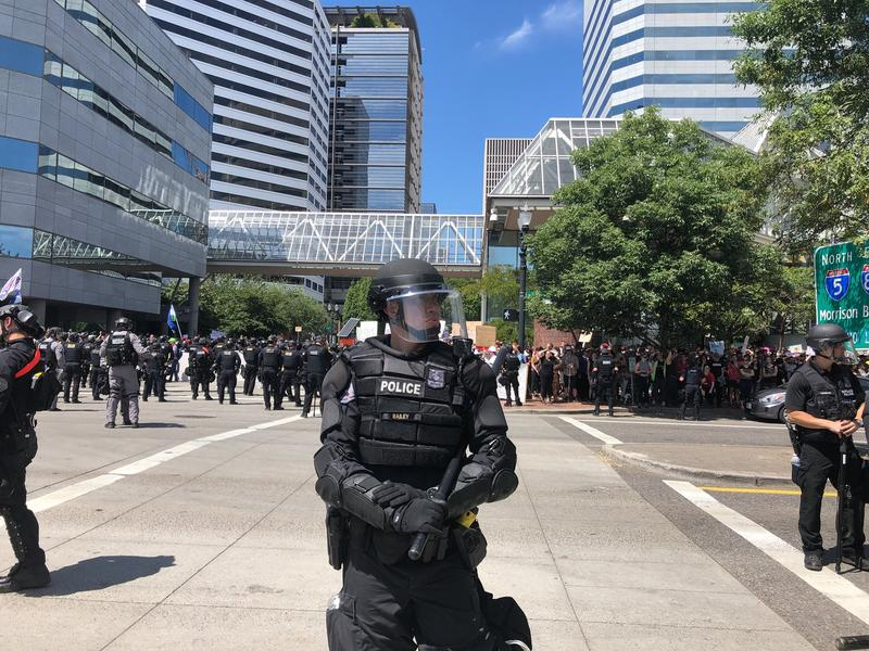A Portland Police Bureau officer controlling the crowd at a protest on Saturday, August 4th, 2018.