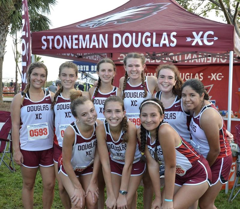 Monique Miquel (top row, second from left) poses with her cross-country team.