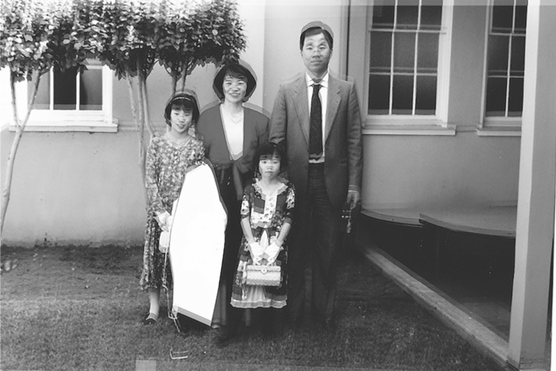 Photo of poet Diana Khoi Nguyen (left) and her family. The negative space in the foreground used to be an image of her brother Oliver, who sliced himself out of the photos with a utility knife. Oliver would go on to commit suicide.