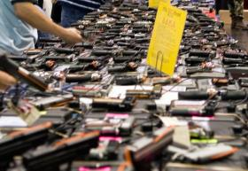 The Houston Gun show at the George R. Brown Convention Center in 2007. Travis County Commissioners are considering doing away with gun shows that take place on publicly-owned property.