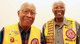 Dr. Charles Akins (left) and Clarence McClure at the Carver Museum in East Austin, a neighborhood they've championed.