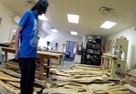 An unnamed volunteer surveys wood pieces for the Psychokinetic Child.