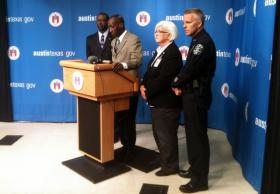 Margo Frasier (second from the right) at a press conference this week. City Manager Marc Ott (second from the left) asked the Justice Department to assess APD use of force policies.