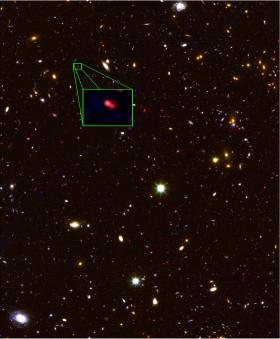This image from the Hubble Space Telescope CANDELS survey highlights the most distant galaxy in the universe with a measured distance, dubbed z8_GND_5296.