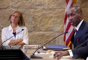 """Austin City Council Member Laura Morrison looks on as Ott speaks. Morrison says defining the separation of powers between the council and the City Manager """"can be a very difficult issue."""""""