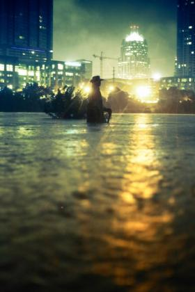 A statue of Stevie Ray Vaughn waist-deep in water, taken the night of the flood.
