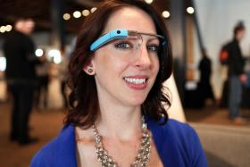 "Amy Langton is one of the Austin Glass Explorers. Langton got the device by winning a Google competition early this year. ""Glass is completely hands-free and now I don't have to worry about dropping anything,"" she says."