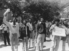 In this circa 1984 photo, apartheid protesters on the UT South Mall ask the university to divest itself of financial holdings in South Africa.