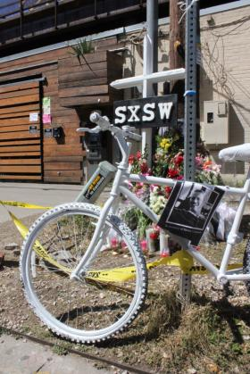 "A ""ghost bike"" is included in a makeshift memorial outside the Mohawk in this photo from March 17."