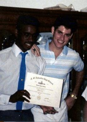 Richard Reddick, left, and Ryan Scarborough upon graduating from Johnston High School in 1990. The two lived in different Austin neighborhoods, but attended the same high school because of school integration policies.