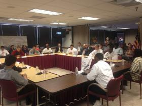 US Education Secretary Arne Duncan sits with local high school and college students of color to get feedback on issues facing young males of color.