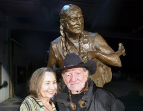 Willie and a friend gets a sneak peek at his bronze likeness.