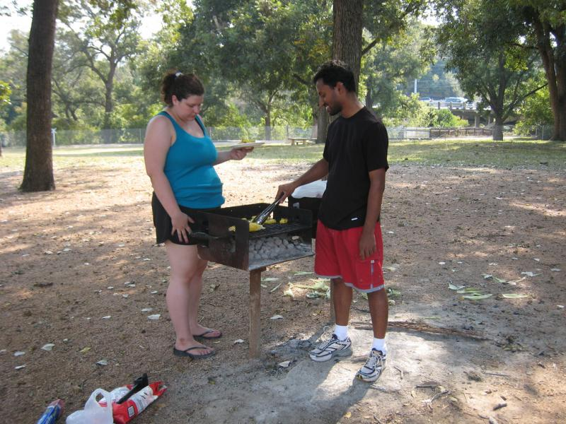 Two people grilling in Zilker Park before the burn ban enacted last April