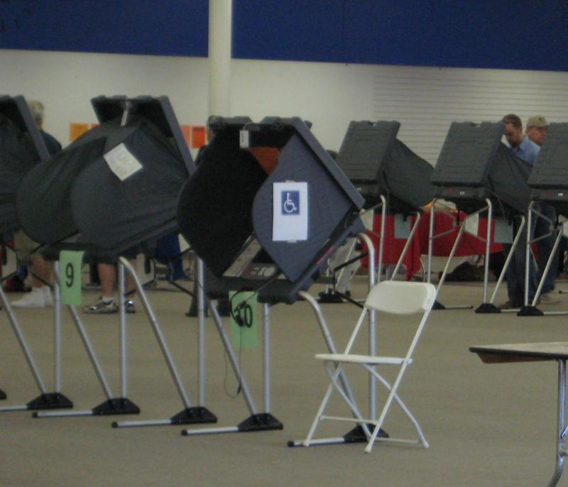 As many Texans go to vote early, there have been reports of voting intimidation.