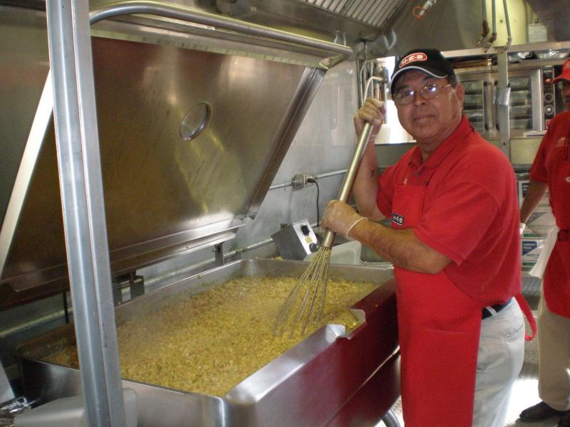 Stirring up the food for the 2009 Feast of Sharing. Today's event is expected to bring out thousands.