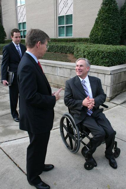 AG Abbott greets Florida Attorney General Bill McCollum outside courthouse