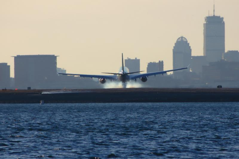 Plane touching down at Logan Airport