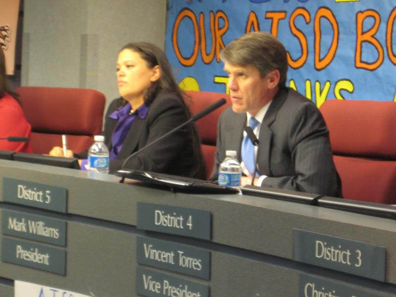 AISD Superintendent Meria Carstarphen and school board president Mark Williams listen to angry parents during public comment period of last night's board meeting.