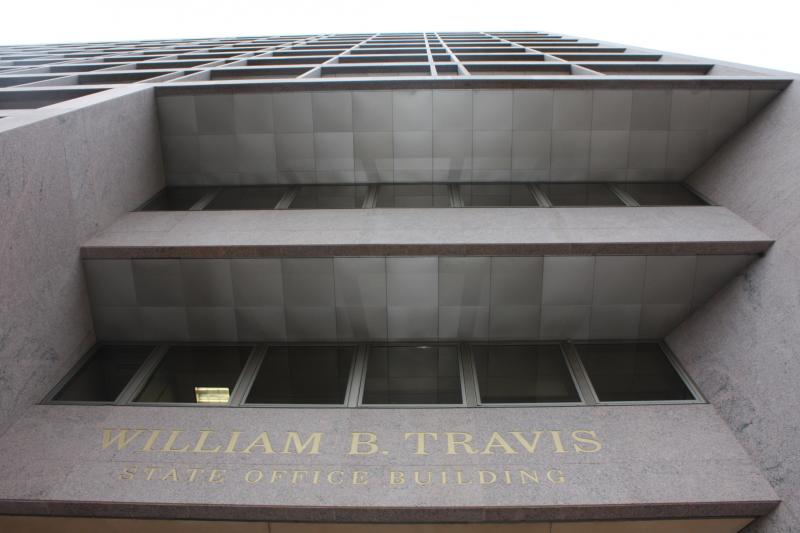 Most Texas Education Agency employees work in the Wililam B. Travis building on Congress Ave. near 17th St. A letter to employees from Education Commissioner Robert Scott is promising job cuts at the agency this year.