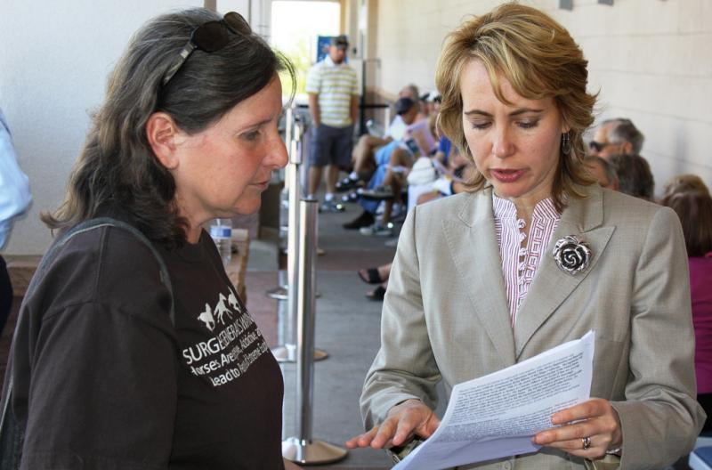 US Congresswoman Gabrielle Giffords (right) speaking to a constituent at a Congress On Your Corner event in May 2010. Giffords was critically wounded yesterday at an event in Tuscon. Six people were killed including a federal judge and a 9-year-old.