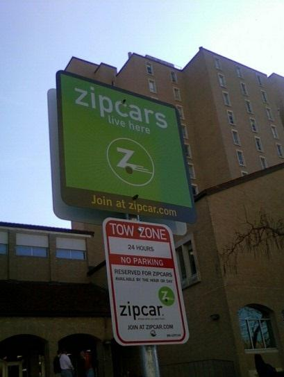 ZipCar starts its car rental service on campus. One of the ZipCar's parking spots is located near the Jester Residence Hall.