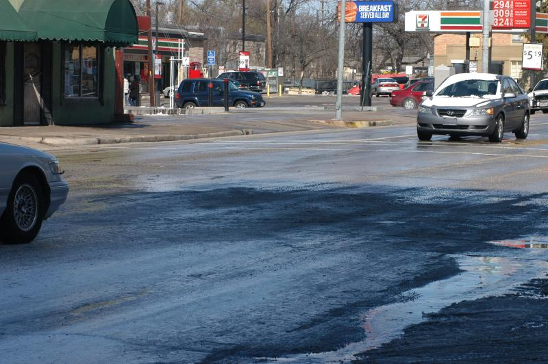 Snow is beginning to melt in some areas that are receiving direct sunlight, like here, at Dean Keaton and Guadalupe Streets.
