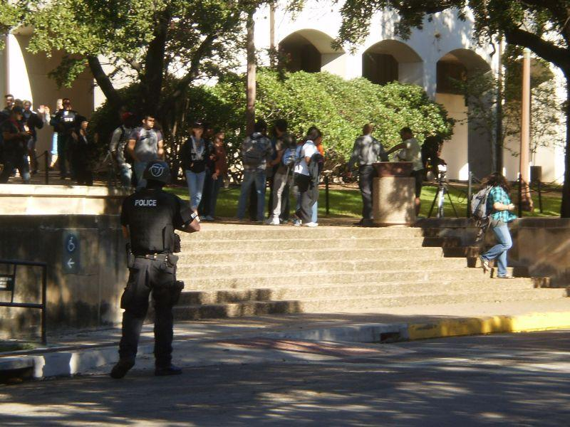 Police escort University of Texas students to safety during the campus shooting incident on September 28, 2010