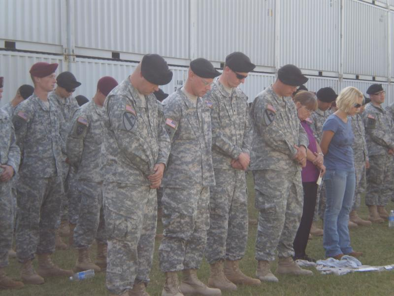 Soldiers bow their heads at a memorial ceremony held days after the Fort Hood shootings in Nov. 2009. A new report suggests the FBI and Army failed to act on information that may have prevented the attack.