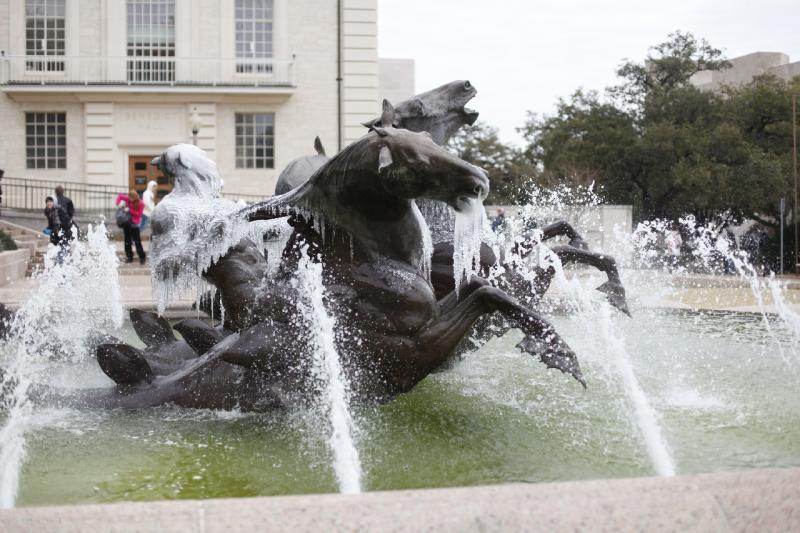 Cold weather caused ice to form on this water fountain at the University of Texas at Austin. The frigid temperatures are being blamed for rolling power outages that afflicated Texas throughout the day.