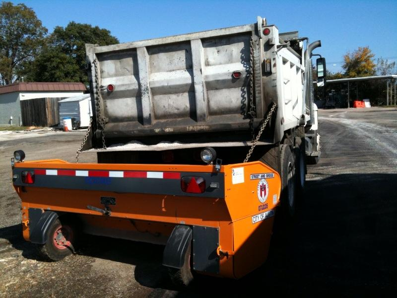 A dump truck outfitted with a sanding device in 2009. The city has 15 trucks ready to clear the city if it snows tonight.