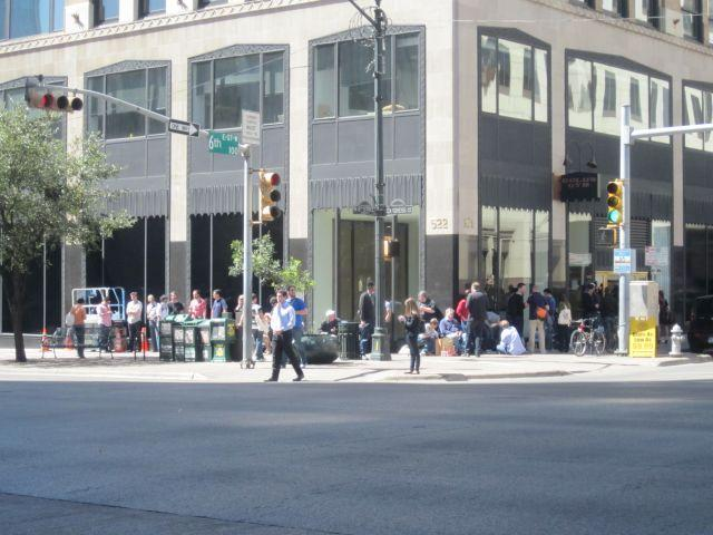 More than two dozen people await the opening of the pop-up Apple Store on Congress and 6th.