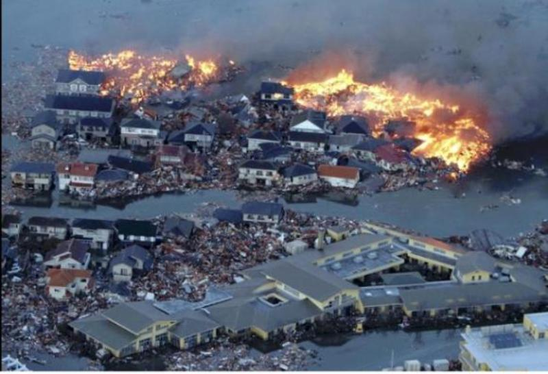 Houses are in flames while the Natori river is flooded in Natori City. Miyagi Prefecture. Yasushi Kanno/The Yominuri Shimbun/AP image via NPR.org