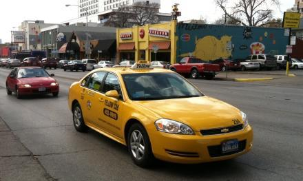 A Yellow Cab cruising down Guadalupe.
