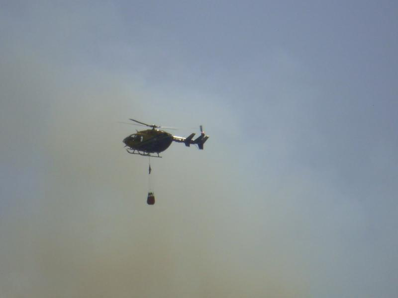 Helicopters have been called in to make retardant drops on the fire near Oak Hill