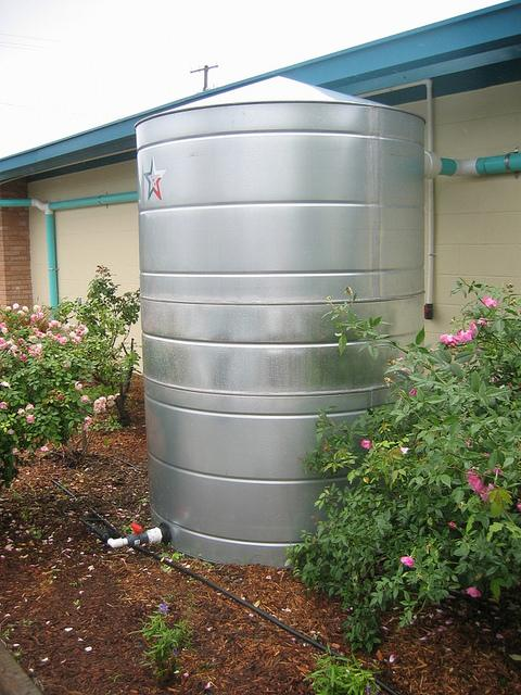Rainwater can be harvested and stored in plastic or metal tanks, like this collection tank which provides water used to irrigate a nearby garden.