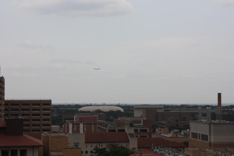 Air Force One flies over the University of Texas campus.