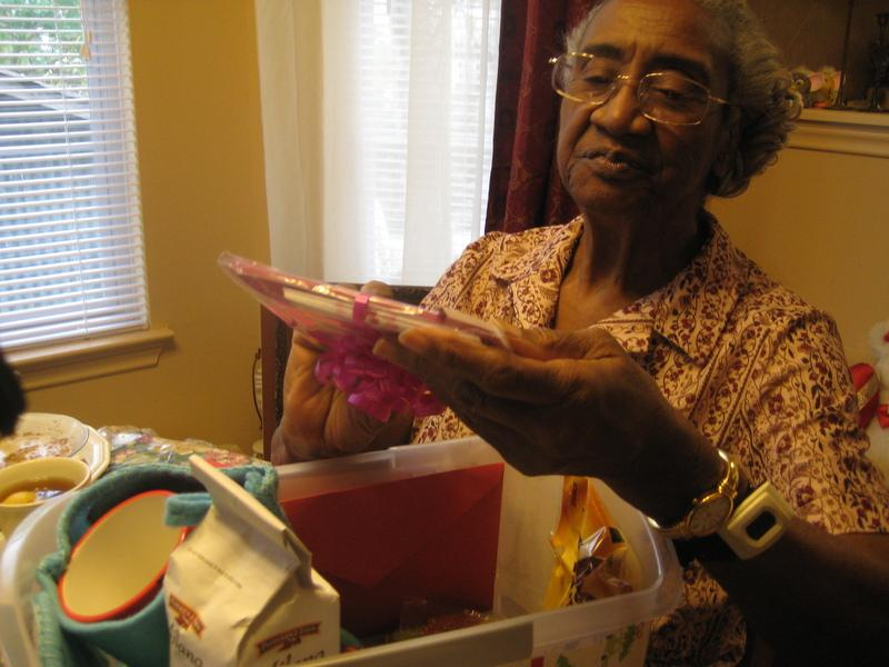 "Ora Lee Clark of Austin admires the gifts she received through Meals on Wheels and More's ""Be a Santa to a Senior"" program in December."