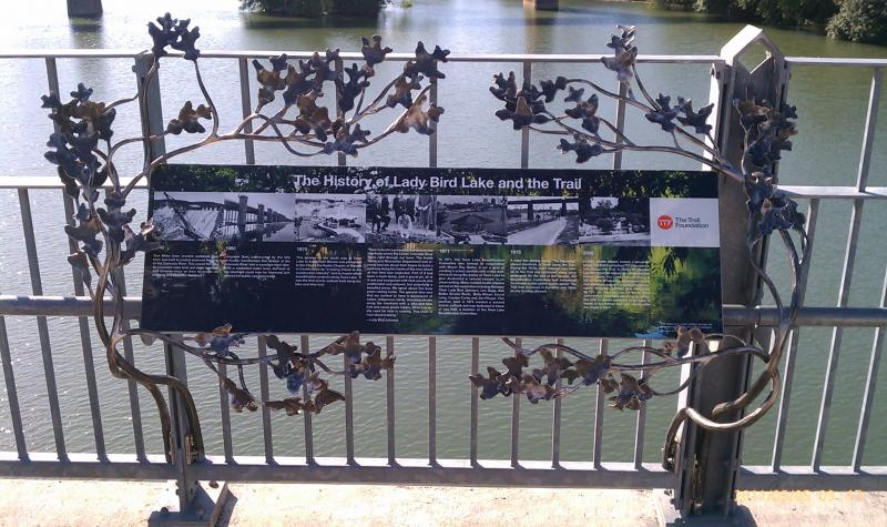 This sign explains the history of the Lady Bird Lake Hike and Bike Trail. It will be ceremonially unveiled at 6 pm today on the Pfluger Pedestrian Bridge.