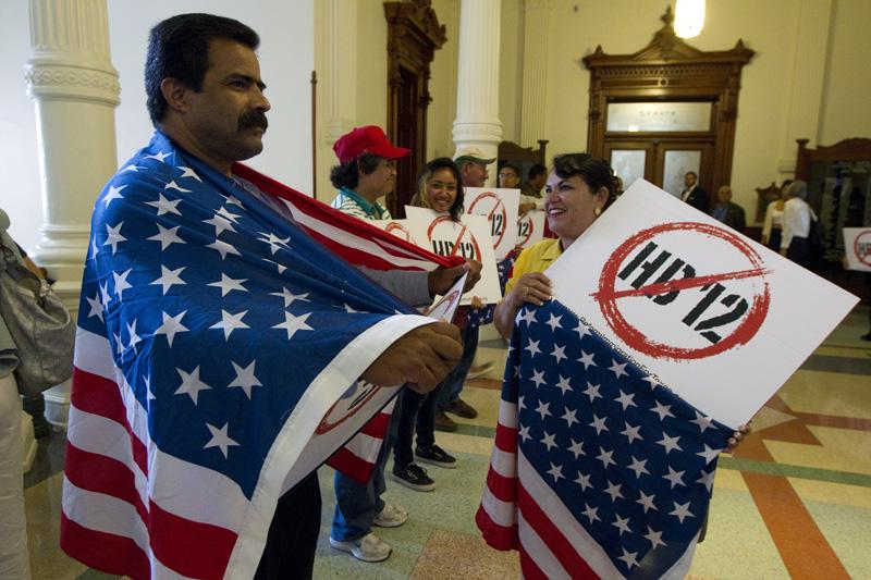 Protesters with signs and American flags line the hallway outside the Senate chamber on sanctuary cities bill HB12 on May 25, 2011.