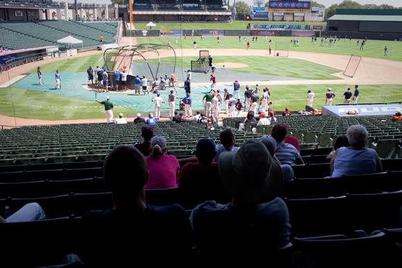 Friends and family watch baseball players take hitting practice for scouts from the Texas Rangers at the Dell Diamond Wednesday morning.