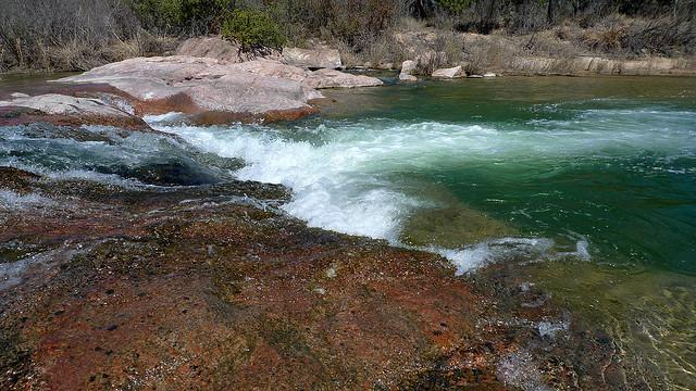 The Llano River's flow fluctuates greatly and is now nearly dry.