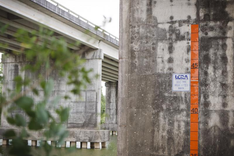 The high water mark under a bridge near a Lower Colorado River Authority pump house that transfers water from the Colorado River to irrigation canals that supply water to the rice fields around Bay City, Texas Friday, June, 10, 2011.