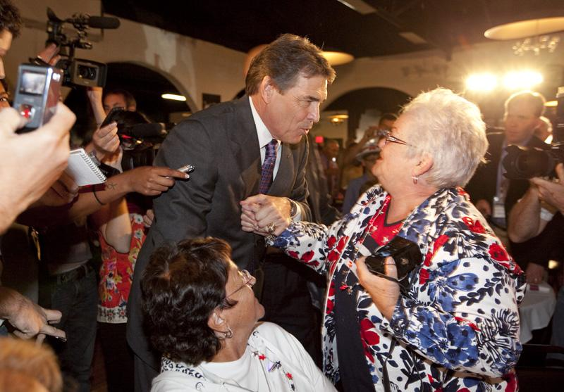 Governor Rick Perry greets a Republican woman at the Electric Park Ballroom on August 14th on his arrival in Iowa.