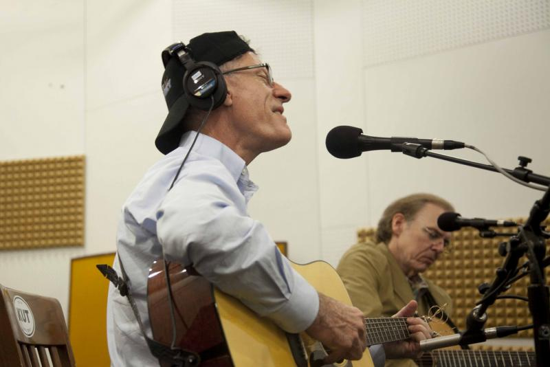 Lyle Lovett, shown performing with John Hiatt at the KUT studios, will be one headliners at a benefit concert for victims of the Bastrop County wildfires.