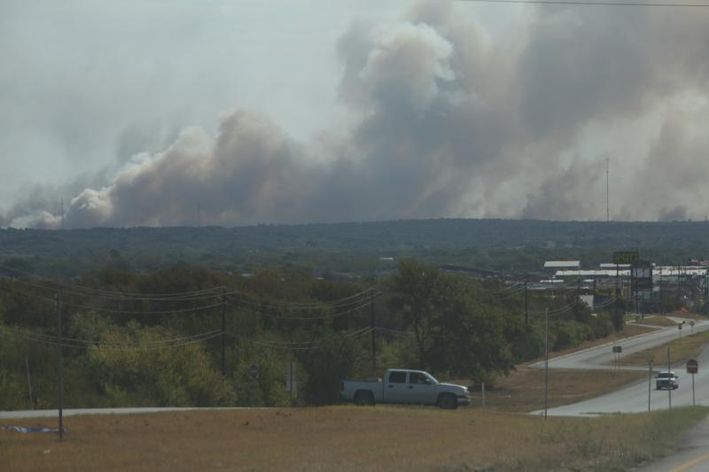 A wildfire in Bastrop was still uncontrolled at midday September 5, 2011. Photo by Lizzie Chen for KUT News.