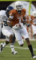 Longhorn Mike Davis on the run as the Texas Longhorns defeated Rice Saturday night 34-9. Photo courtesy of University of Texas at Austin athletics.