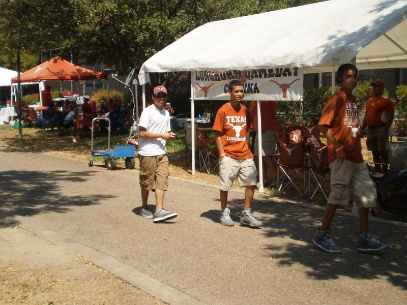 Longhorn fans set up tailgate tents and spots early Saturday morning on the UT campus for the football season opener against Rice University.